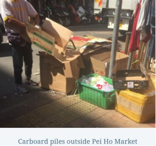 cardboard piles with caption